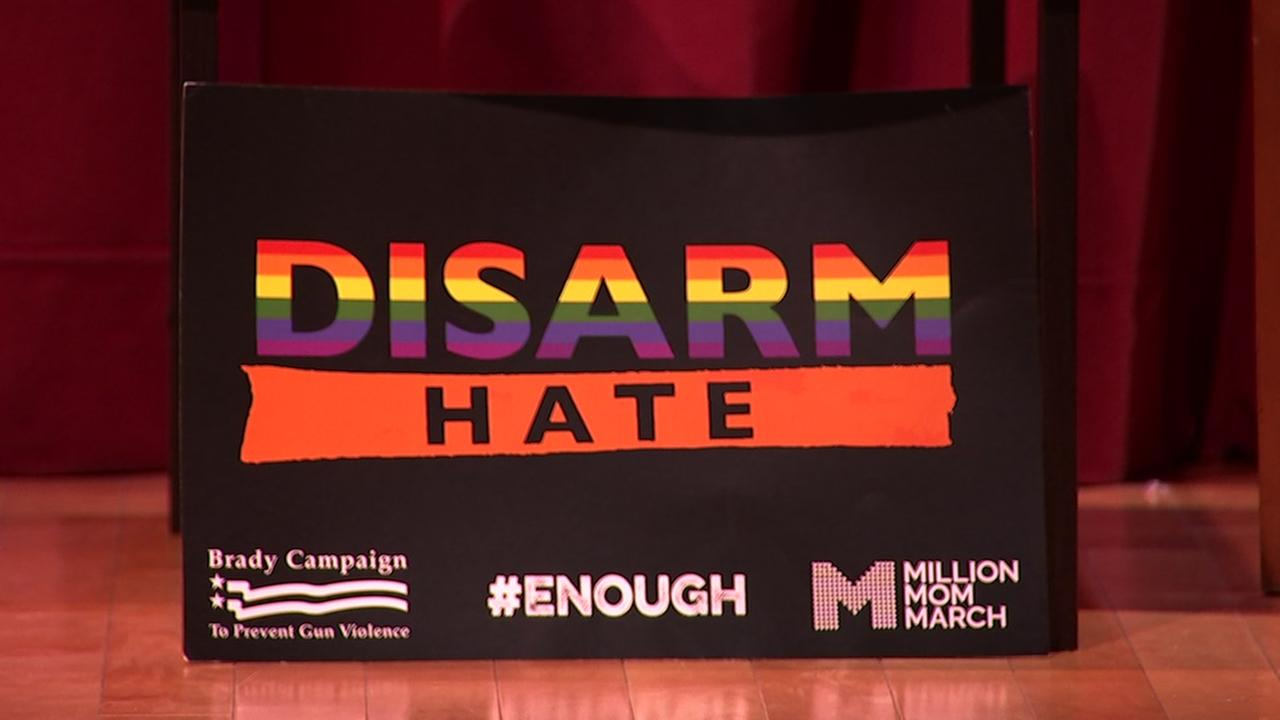A sign that reads, Disarm Hate appears at a gun control panel at Grace Cathedral Church in San Francisco on Tuesday, March 20, 2018.