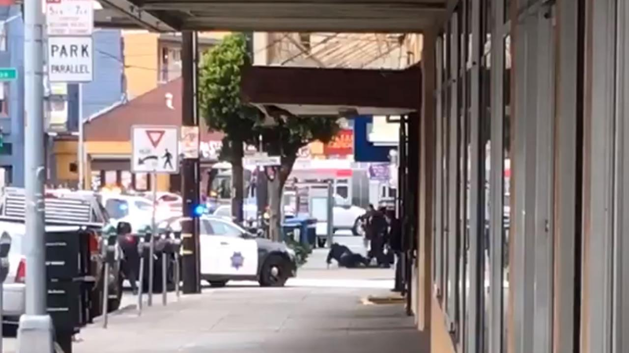 This image taken from a witness video shows a San Francisco officer, who was just shot, crawling to a police car on Wednesday, March 21, 2018.
