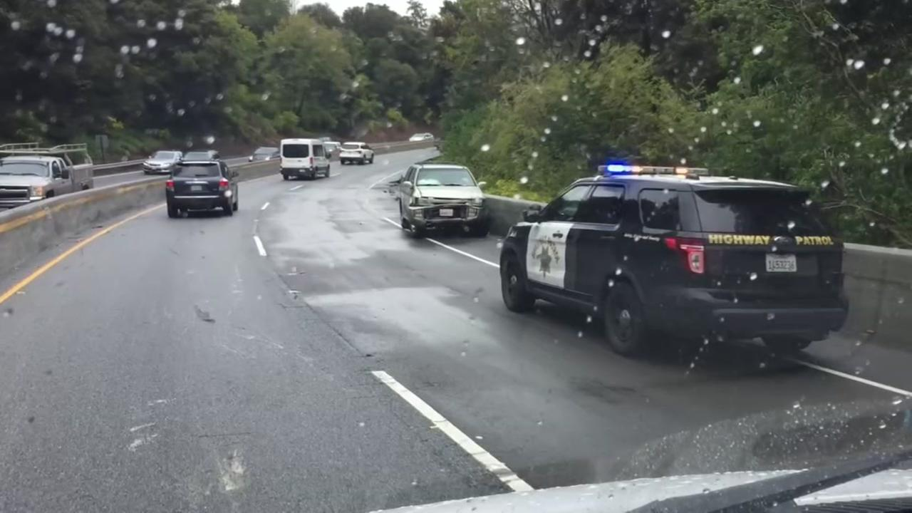 A police car appears on Highway 17 during a rain storm on Thursday, March 22, 2018.