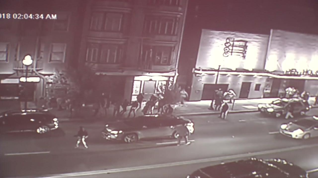 Surveillance video shows fights on Broadway in San Francisco.