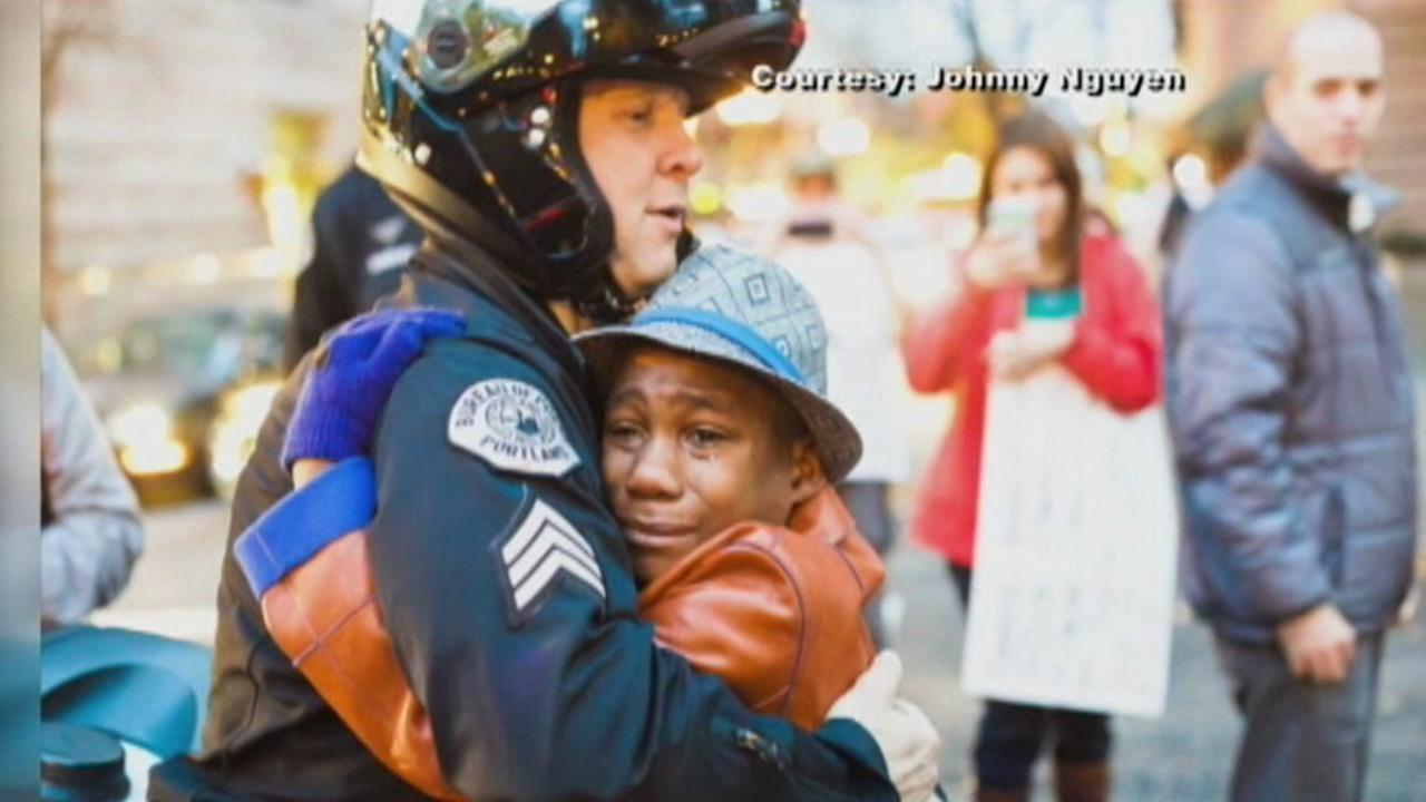Devonte Hart is seen hugging a Portland, Oregon Police Sergeant in this undated image.