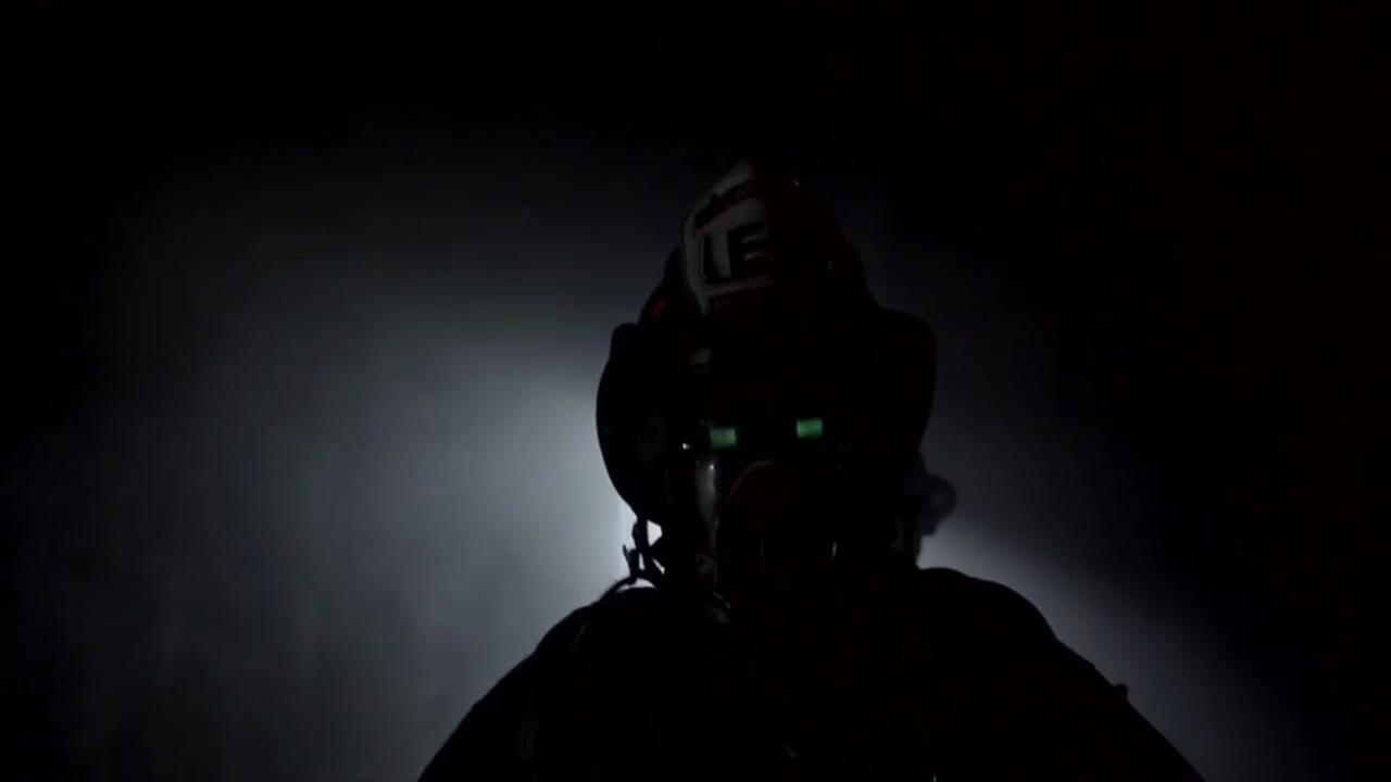 A Menlo Park firefighter tests a mask that lets him see through smoke.