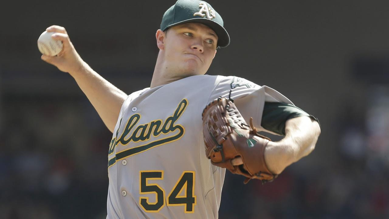 Oakland Athletics starting pitcher Sonny Gray throws during the first inning of a baseball game against the Texas Rangers, Sept. 28, 2014, in Arlington, Texas. (AP Photo/LM Otero)