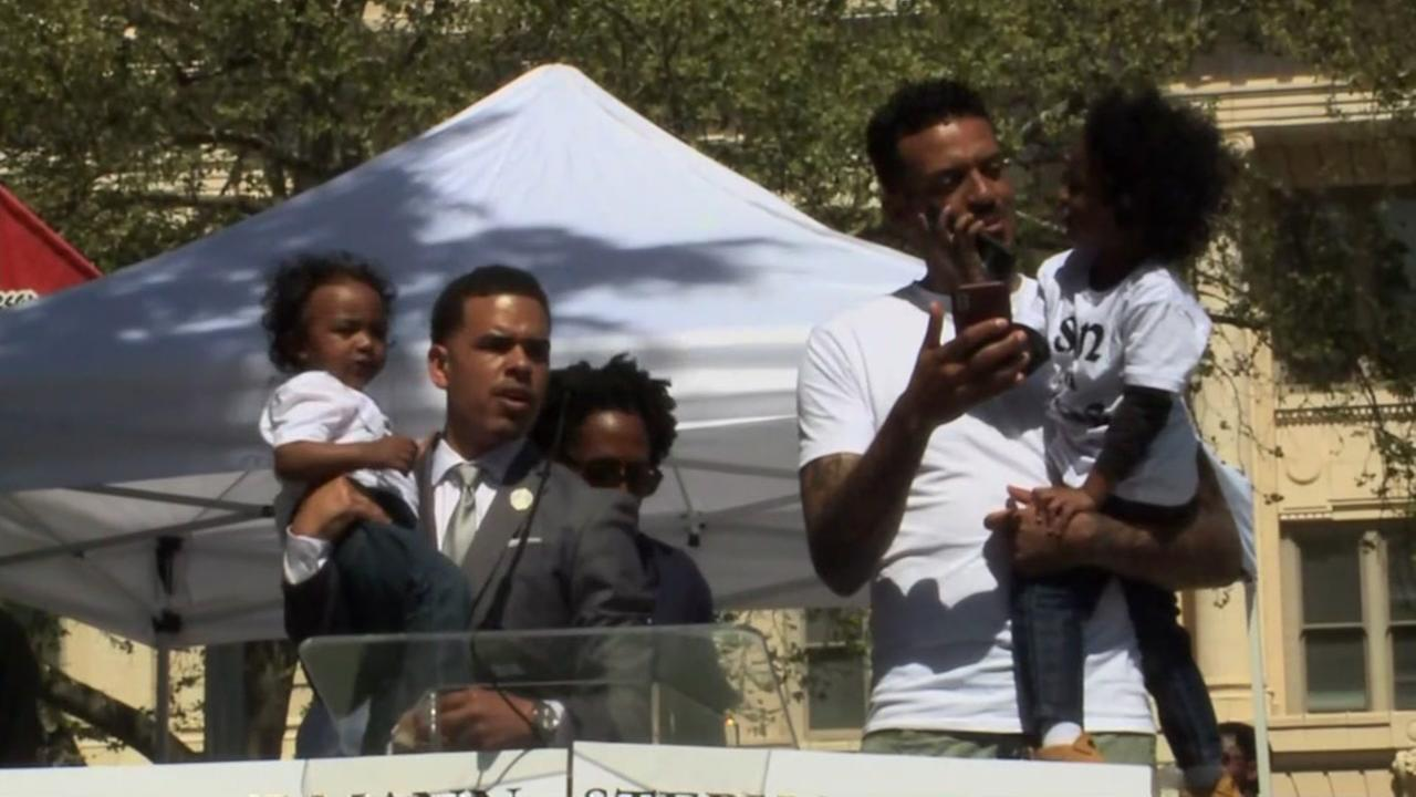 Matt Barnes is seen with the children of Stephon Clark during a rally in Sacramento on Saturday, March 31, 2018.