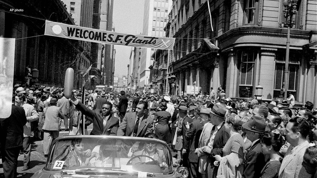 Outfielder Willie Mays grabs a balloon during a parade on April 14, 1958 to welcome the Giants to San Francisco after their move from New York.