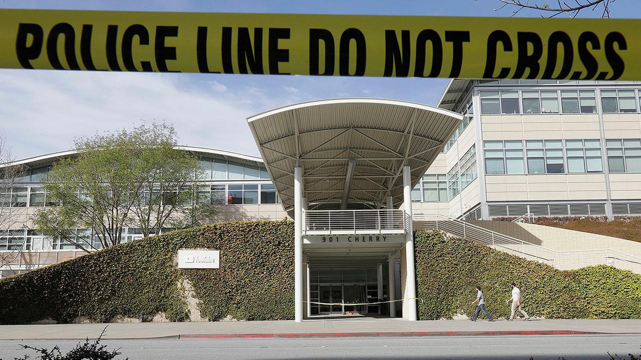 Police tape is shown outside of a YouTube office building in San Bruno, Calif., Wednesday, April 4, 2018.