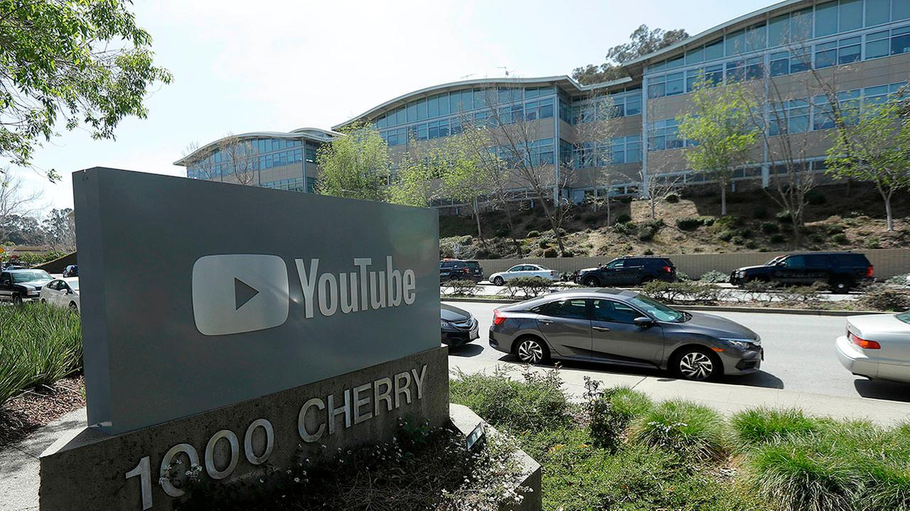 FILE- In this April 3, 2018, file photo, a YouTube sign is shown across the street from the companys offices in San Bruno, Calif