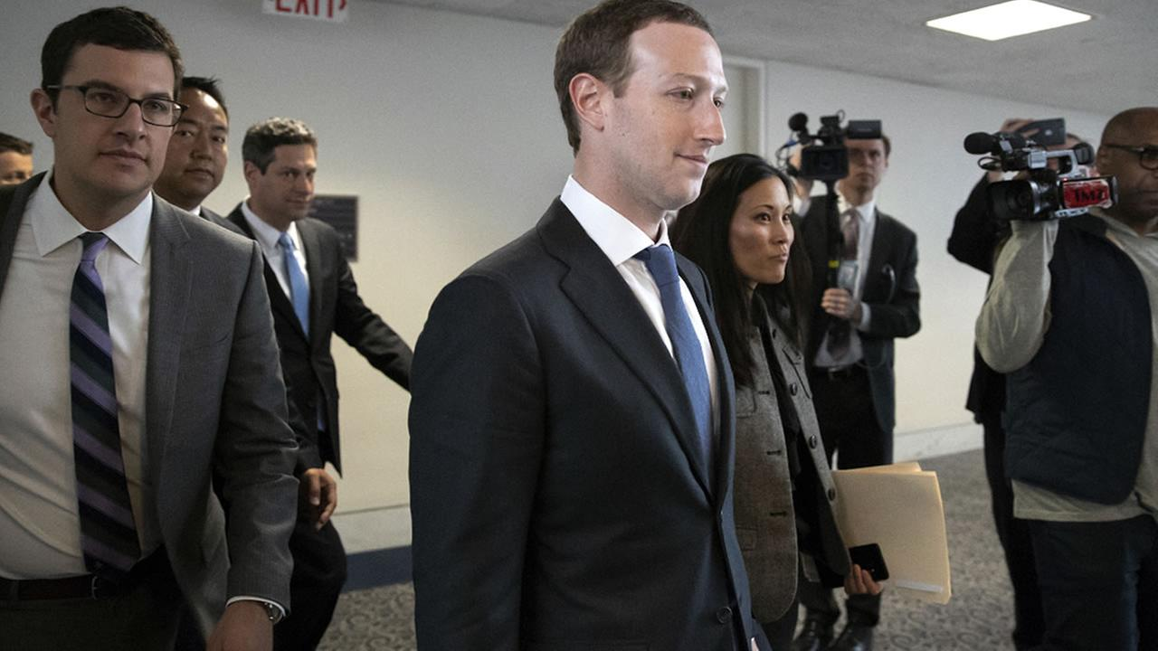 Facebook CEO Mark Zuckerberg leaves a meeting on Capitol Hill in Washington, Monday, April 9, 2018. (AP Photo/J. Scott Applewhite)