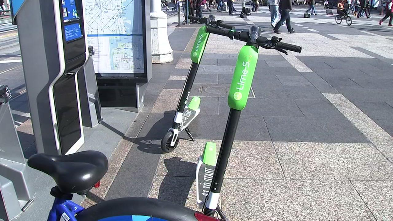 This is an undated image of dockless scooters.