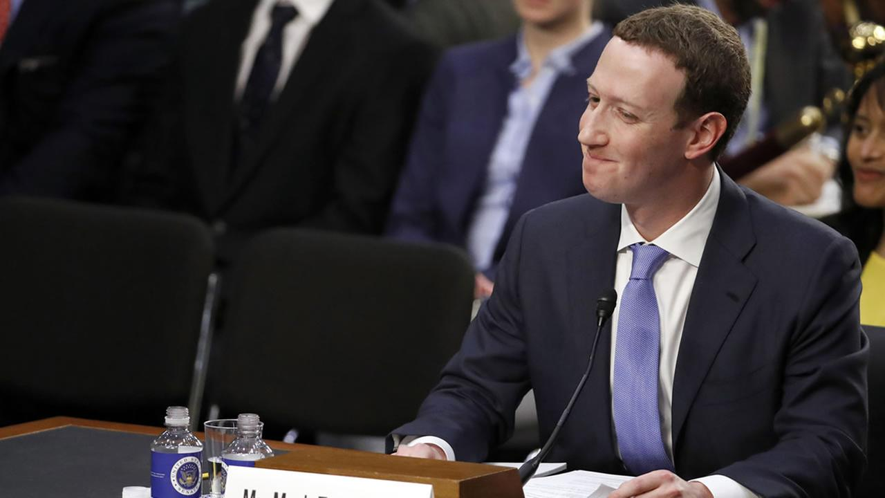 Facebooks Mark Zuckerberg reacts to a question as he testifies before a joint hearing on Capitol Hill in Washington, Tuesday, April 10, 2018.