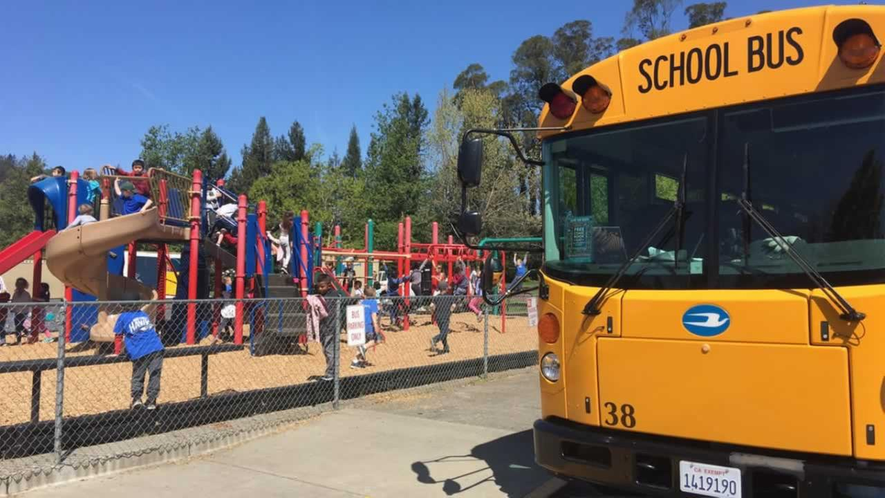 A school bus is parked in front of a Santa Rosa, Calif. school on Friday, April 13, 2018.
