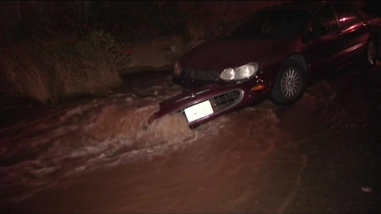 Water main break floods cars in San Franciscos Bayview District.