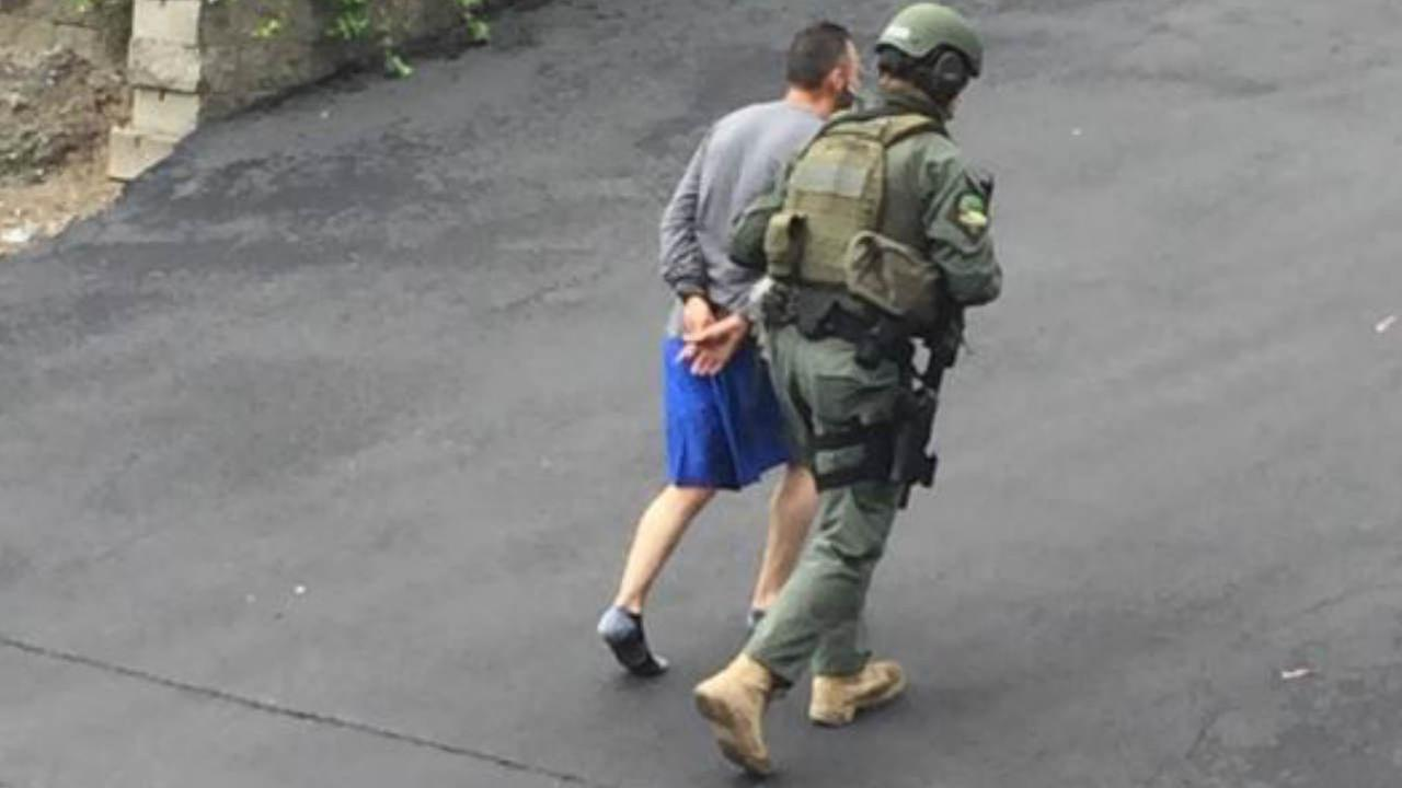 A burglary suspect is seen being taken into custody in San Rafael, Calif. on Monday, April 16, 2018.