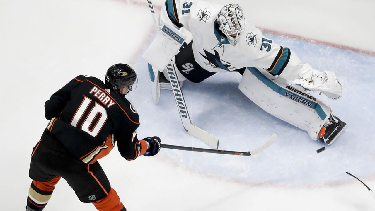 San Jose Sharks goaltender Martin Jones blocks a shot by Anaheim Ducks Corey Perry in an NHL hockey first-round playoff series in Anaheim, Calif., Saturday, April 14, 2018.