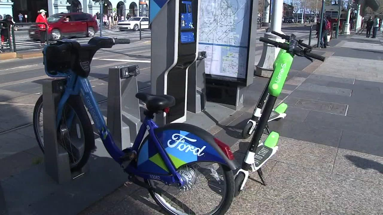 A Lime scooter and a CitiBike appear in San Francisco on Monday, April 16, 2018.
