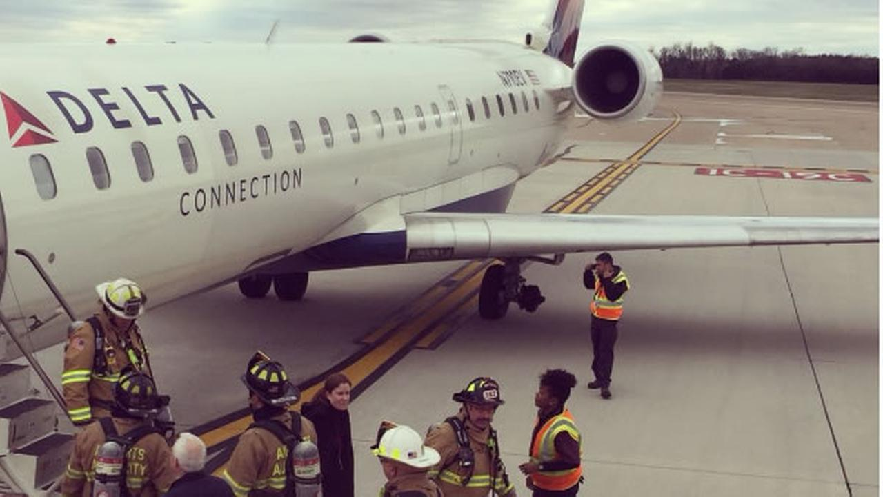 A Delta plane is seen after making an emergency landing at Dulles International Airport on Tuesday, April 17, 2018.