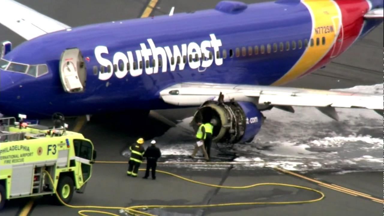 The Southwest flight with a blown out engine appears after its emergency landing in Philadelphia on Tuesday, April 17, 2018.