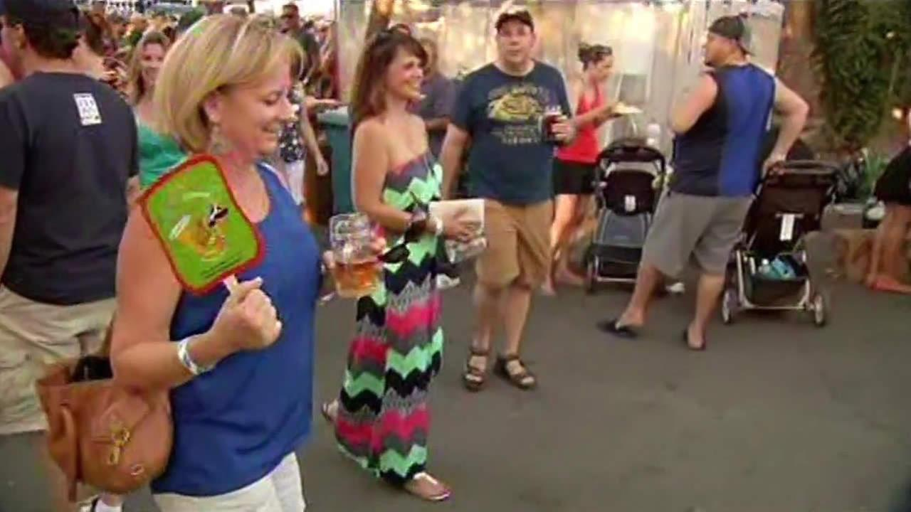 A woman fans herself at an Oktoberfest celebration in Walnut Creek.