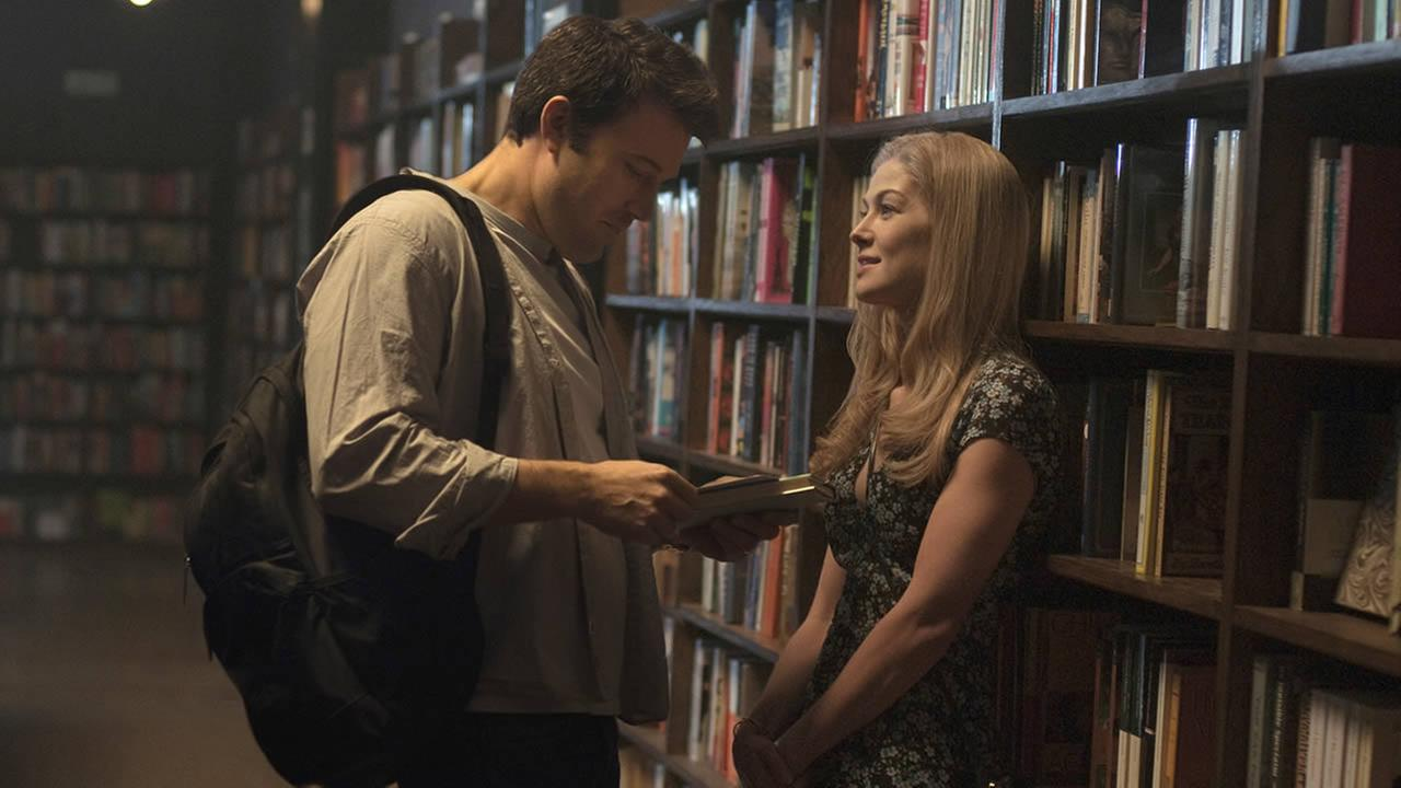 In this image released by 20th Century Fox, Ben Affleck, left, and Rosamund Pike appear in a scene from Gone Girl. (AP Photo/20th Century Fox, Merrick Morton)