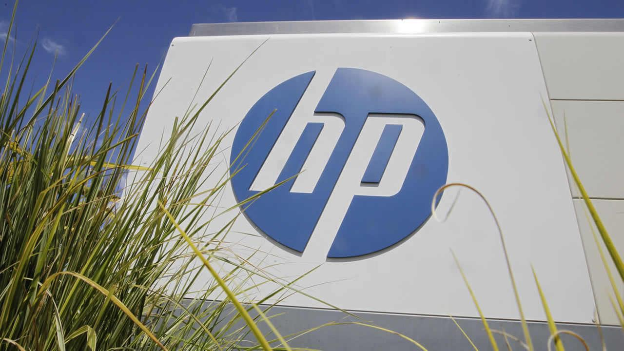 In this Aug. 21, 2012, file photo, the Hewlett-Packard Co. logo is seen outside the companys headquarters in Palo Alto, Calif. (AP Photo/Paul Sakuma, File)