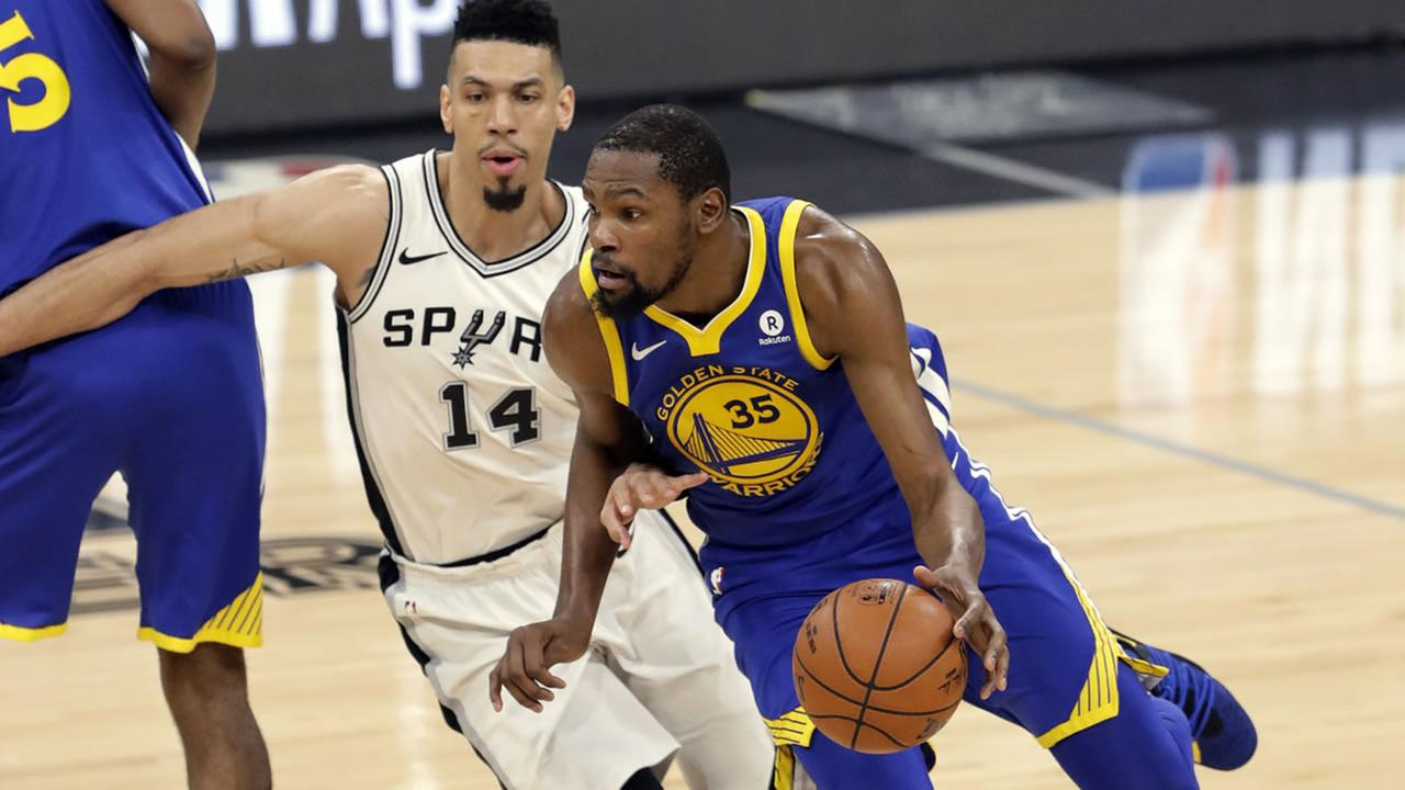 San Antonio Spurs Danny Green defends as Warriors Kevin Durant drives during Game 3 of a first-round NBA basketball playoff series in San Antonio, Thursday, April 19, 2018.