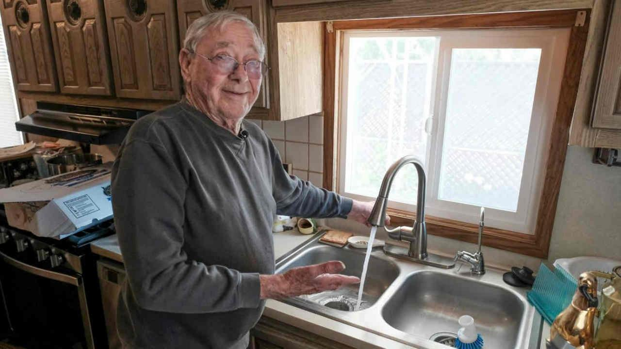 John Triglia is seen at the sink of his new home in this undated image.