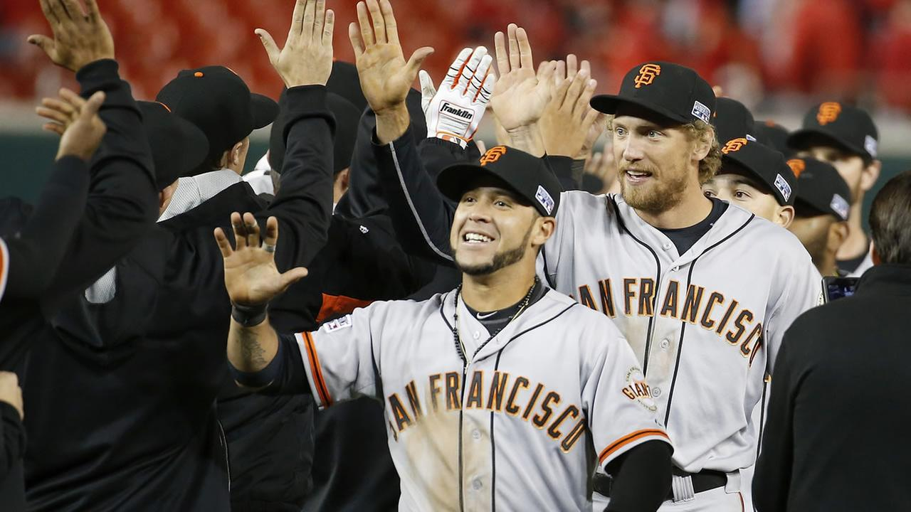 Giants celebrate their 2-1 victory over the Nationals