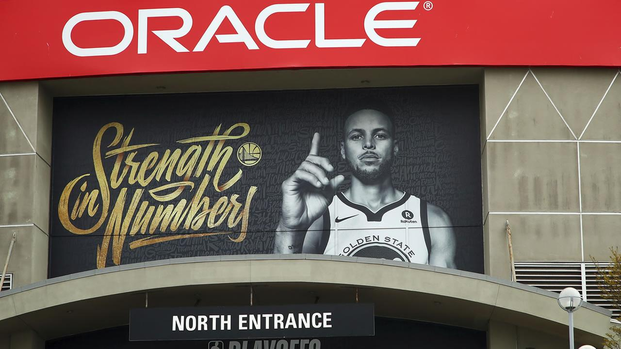 A banner depicting Golden State Warriors Stephen Curry hangs on the exterior of Oracle Arena on Tuesday, April 10, 2018, in Oakland, Calif.