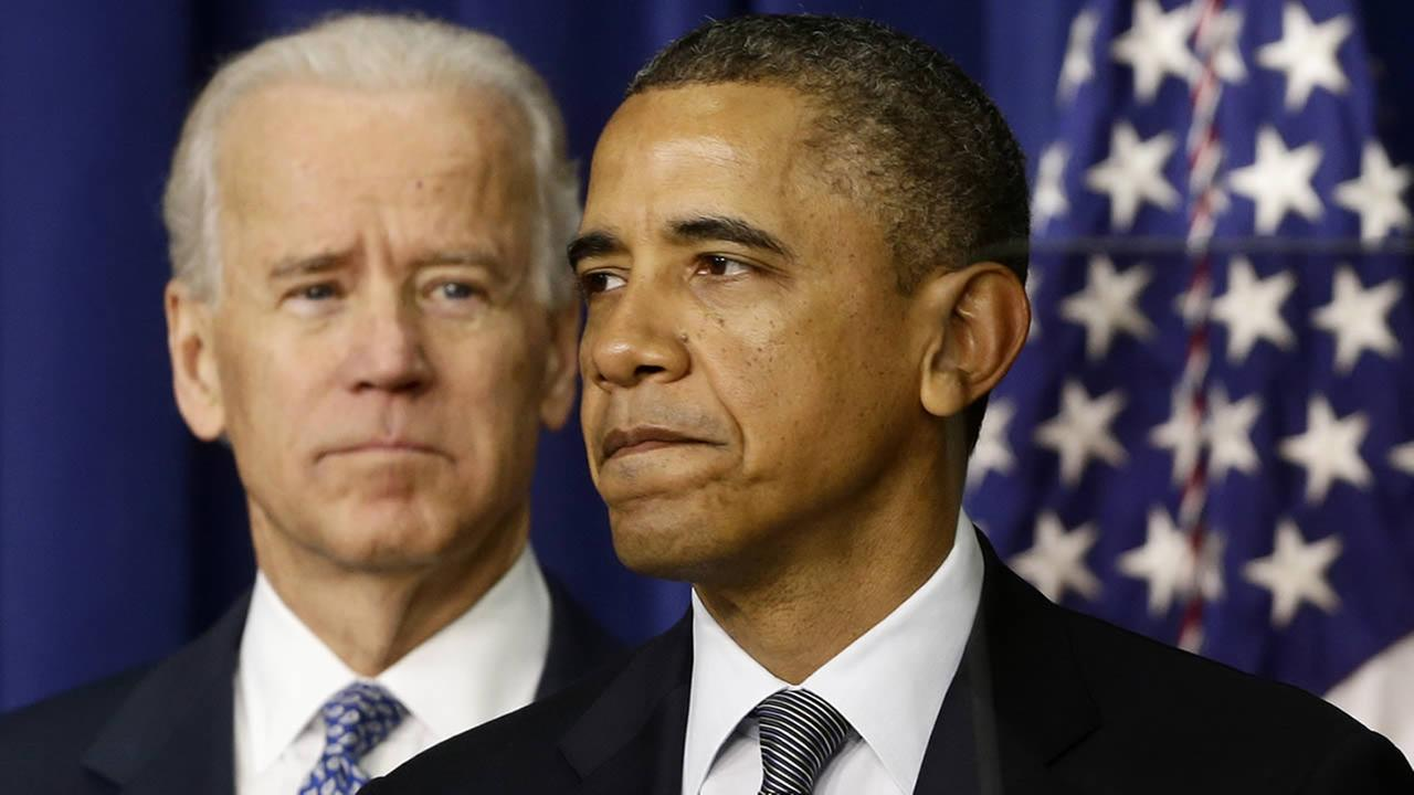 President Barack Obama and Vice President Joe Biden, Wednesday, Jan. 16, 2013, in the South Court Auditorium at the White House in Washington. (AP Photo/Charles Dharapak)