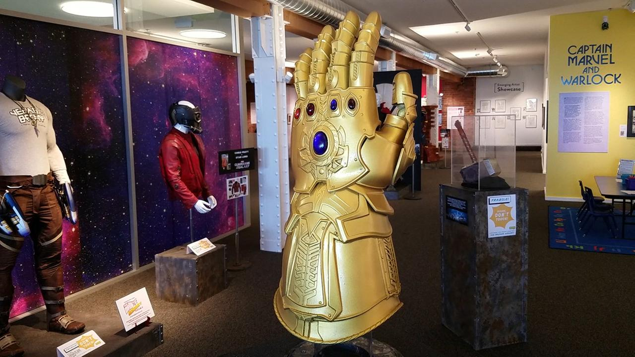 A reproduction of the Infinity Gauntlet is on display as part of an exhibit on Avengers costumes and props at The Cartoon Museum in San Francisco, CA.