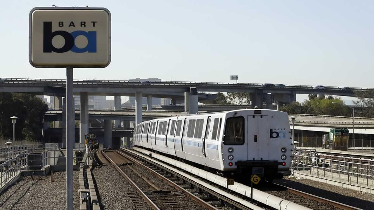 FILE -- A BART train leaves the station Tuesday, Oct. 15, 2013, in Oakland, Calif. (AP Photo/Ben Margot)