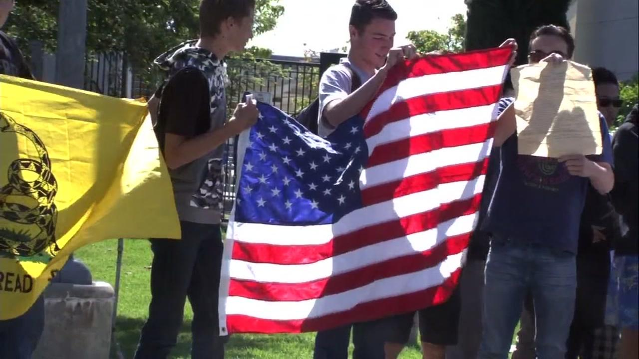 San Ramon students are seen holding the U.S. flag in support of the Second Amendment on Wednesday, May2, 2018.