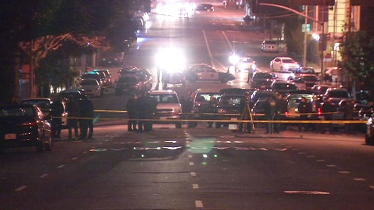 Police investigate a fatal officer-involved shooting near AT&T Park in San Francisco on October 7, 2014.