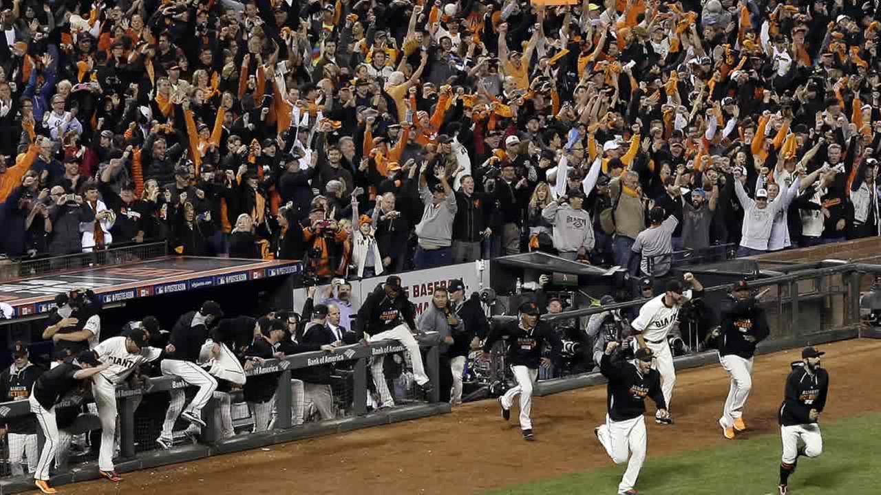 The San Francisco Giants run out of the dugout after they beat the Washington Nationals 3-2 to win Game 4 of baseballs NL Division Series in SanFrancisco, Oct. 7, 2014. (AP Photo/Eric Risberg)