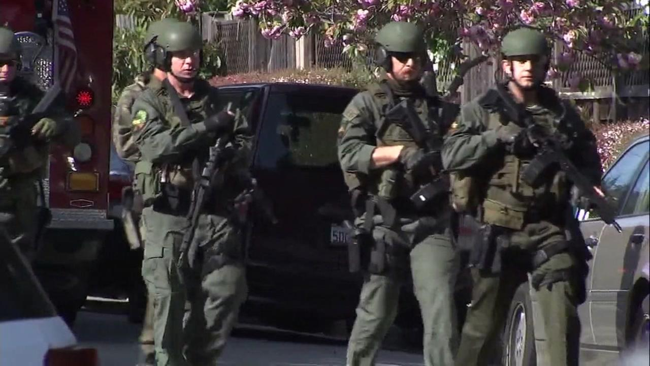 SWAT officials march near the scene of a shooting in Mill Valley, Calif. on Thursday, May 3, 2018.