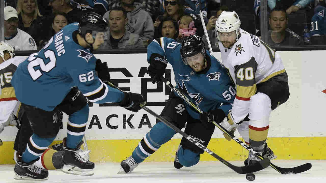 San Jose Sharks Kevin Labanc, and Chris Tierney vie for the puck against Vegas Golden Knights Ryan Carpenter during Game 6 of an NHL hockey playoff series Sunday, May 6, 2018