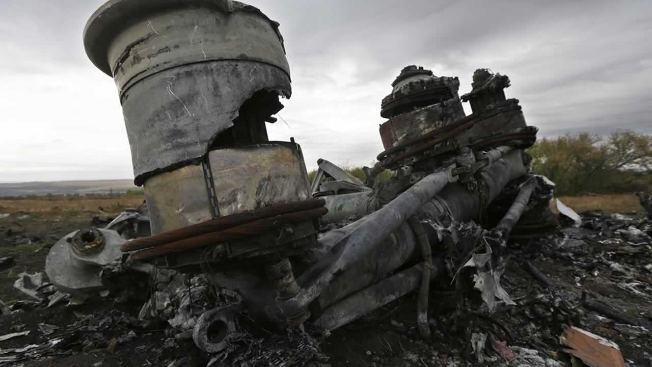Pieces of the Malaysia Airlines Flight 17 plane are seen near village of Hrabove, eastern Ukraine, Tuesday, Sept. 9, 2014.