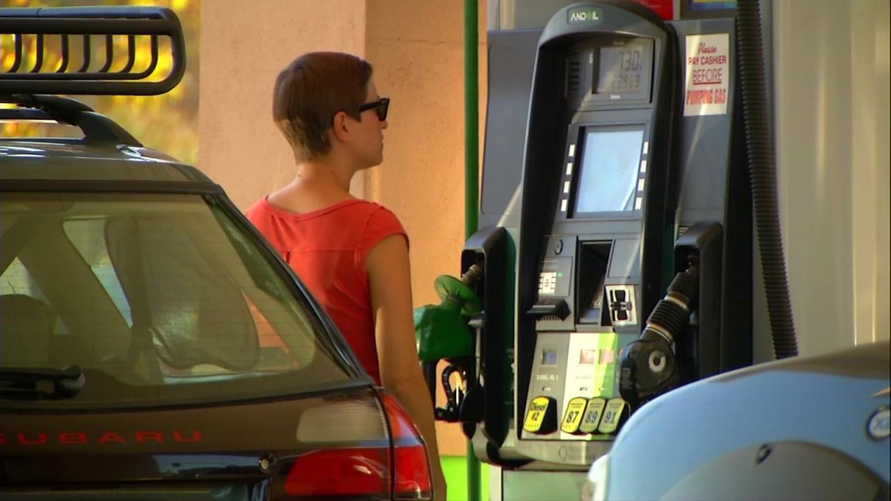 A woman is seen pumping gas in this undated image.