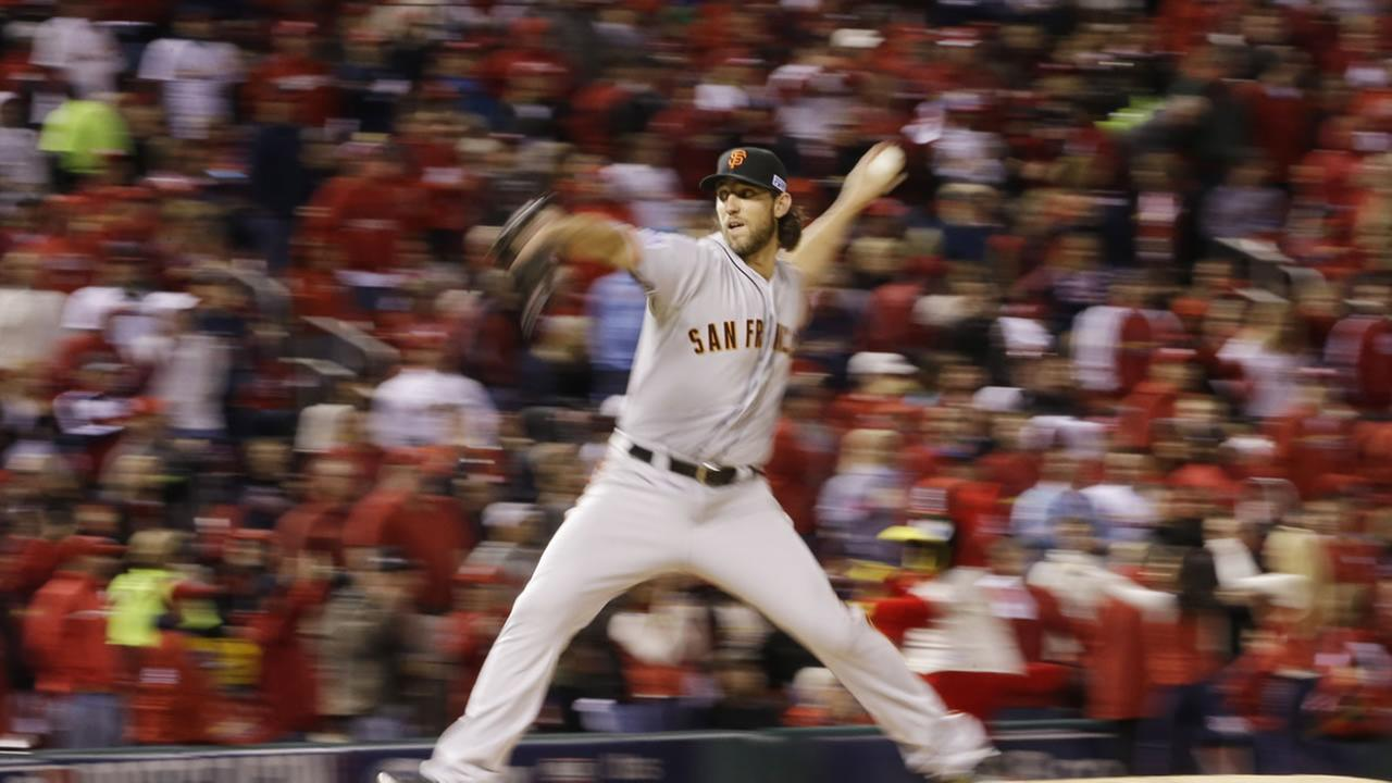 San Francisco Giants starting pitcher Madison Bumgarner throws in Game 1 of the NLCS against the St. Louis Cardinals Saturday.(AP Photo/David J. Phillip)