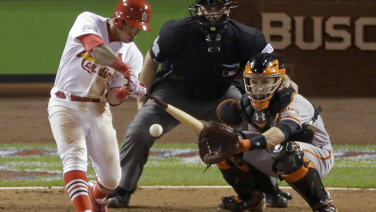 St. Louis Cardinals Kolten Wong hits a walk off home run during the ninth inning in Game 2 of the National League baseball championship series against the San Francisco Giants Sunday, Oct. 12, 2014, in St. Louis. The Cardinals won 5-4 (AP Photo/Eric Gay)