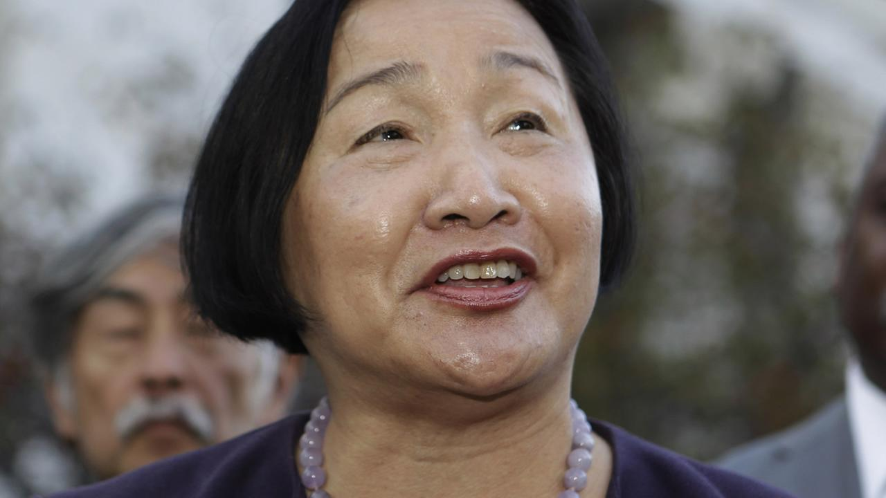 Oakland Councilwoman Jean Quan smiles during a news conference in front of Oakland City Hall in Oakland, Calif., Monday, Nov. 8, 2010.(AP Photo/Paul Sakuma)