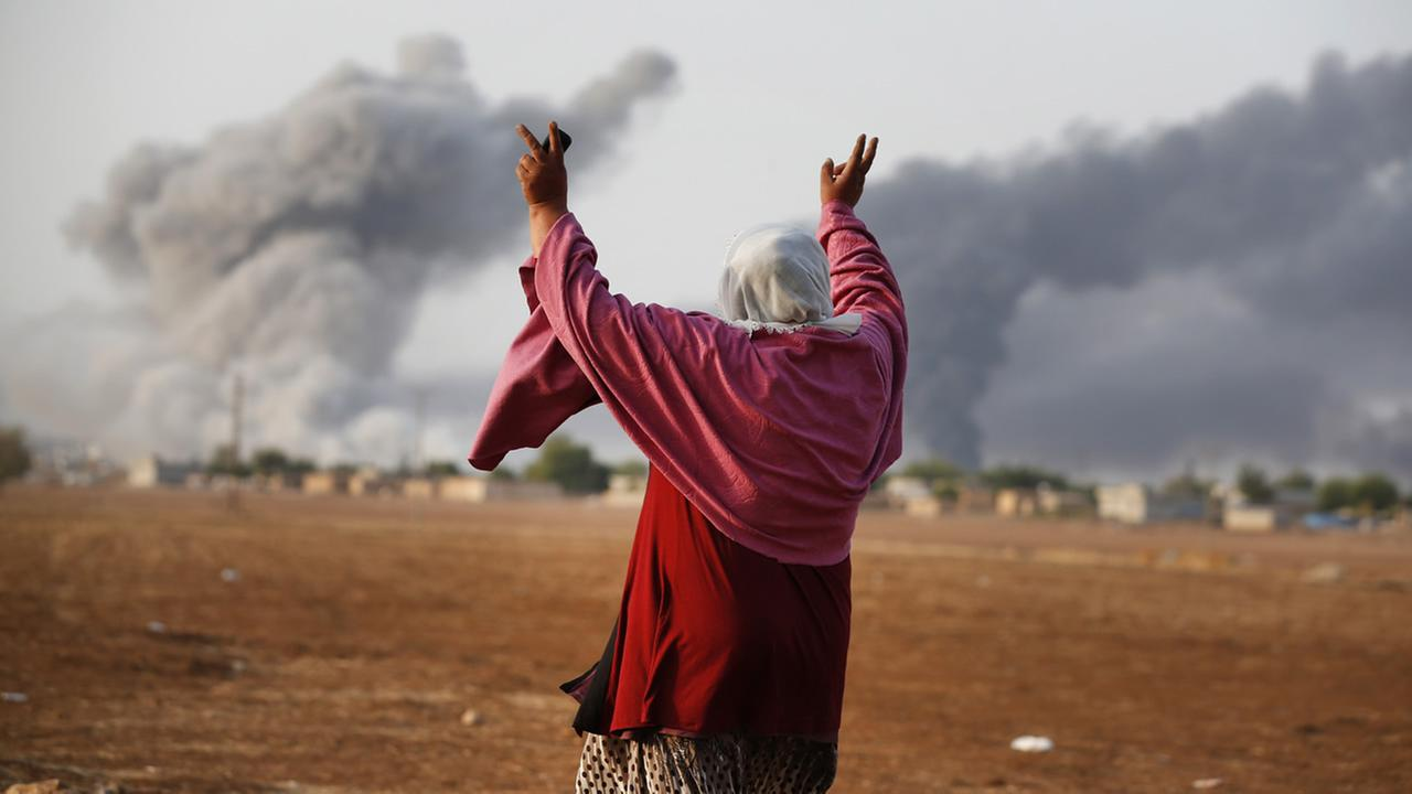 A thick smoke rises following an airstrike by the US-led coalition in Kobani