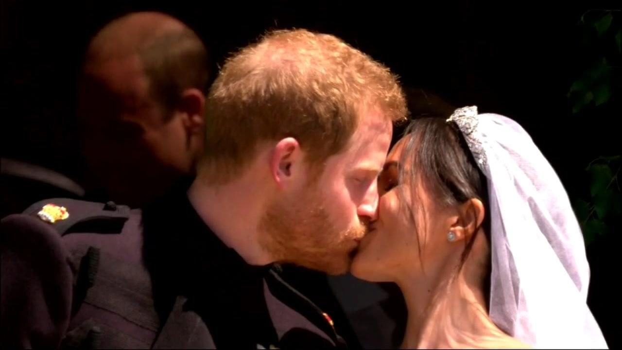 Prince Harry and Meghan, Duchess of Sussex, are seen kissing in Windsor, England on Saturday, May 19, 2018.