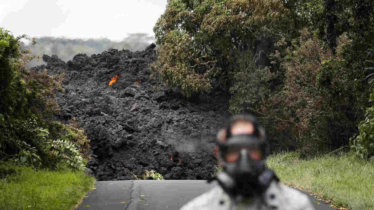 Lava enters the ocean off Highway 137 near Pahoa, Hawaii, Sunday, May 20, 2018.