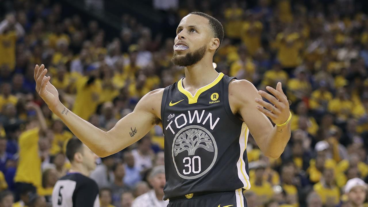 Warriors guard Stephen Curry (30) reacts during Game 4 of the NBA Western Conference Finals between the Warriors and the Houston Rockets in Oakland, Calif., Tuesday, May 22, 2018.