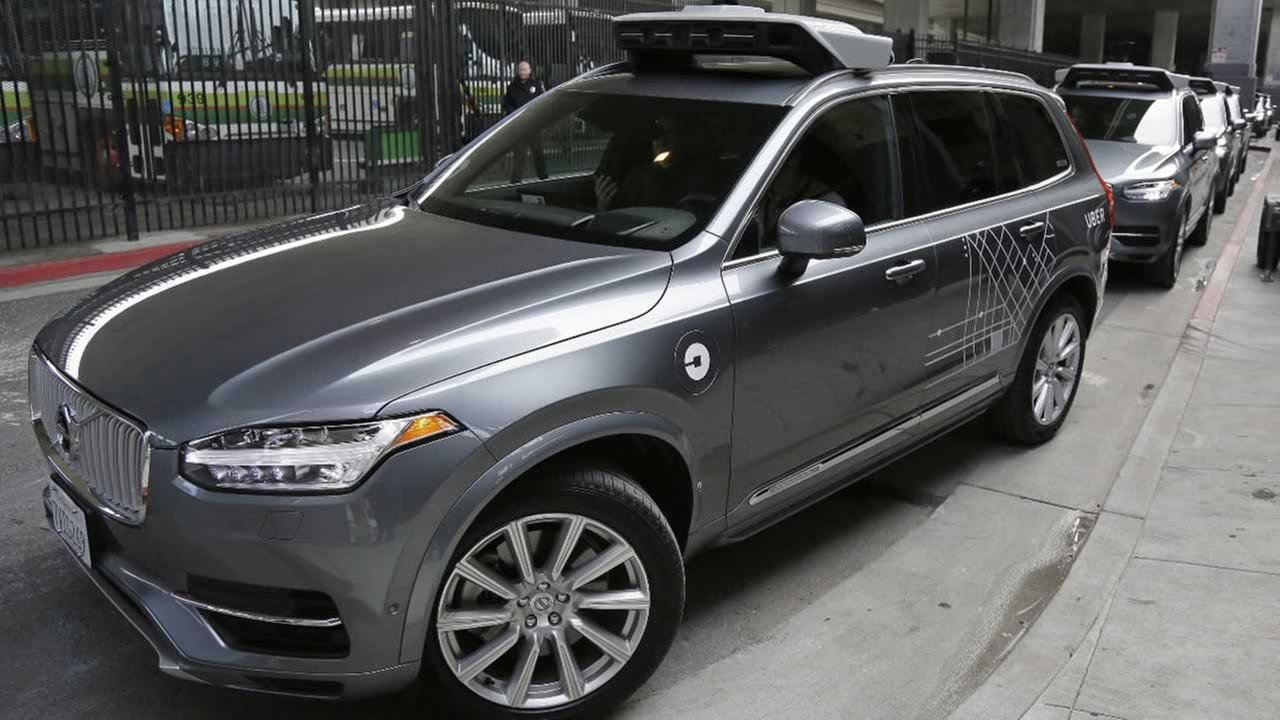 In this Dec. 13, 2016 file photo, Ubers autonomous car heads out for a test drive in San Francisco.