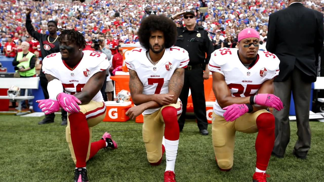 Colin Kaepernick kneels alongside fellow 49ers player in this undated image from 2016.