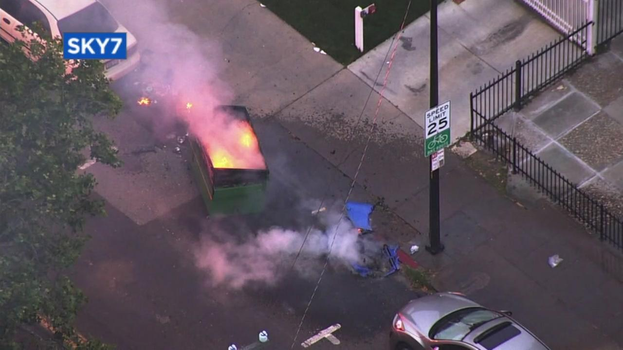 A dumpster appears to be on fire in San Jose, Calif. on Thursday, May 24, 2018.