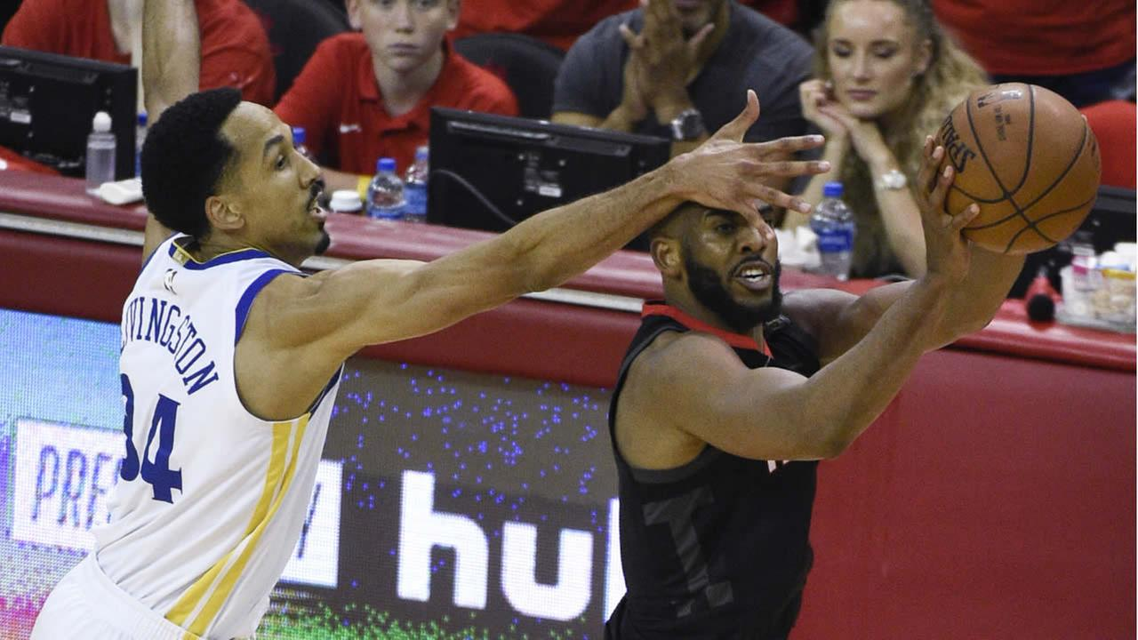 Rockets Chris Paul shoots as Warriors Shaun Livingston defends during Game 5 of the NBA basketball playoffs Western Conference finals, May 24, 2018, in Houston. (AP Photo)