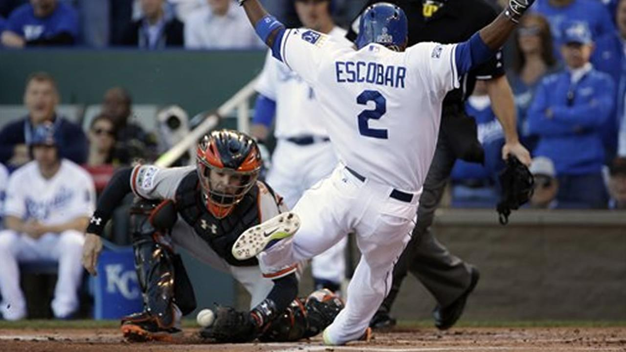 Kansas City Royals Alcides Escobar slides into home